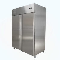 Upright two door fridge on castors